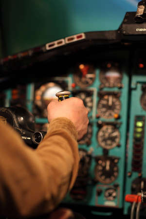 The pilot aviates the old airliner by control column photo