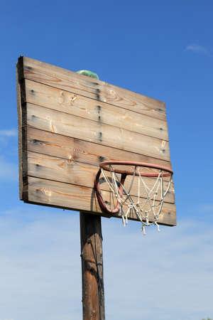backboard: The Wooden Basketball Hoop on the sky background