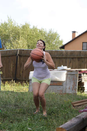The basketball player plays in the garden photo