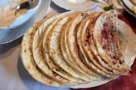 azerbaijanian: Heap of Qutab on the plate in azerbaijanian restaurant Stock Photo