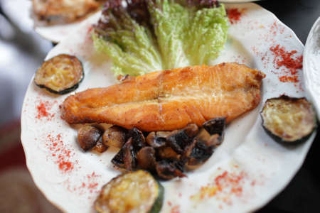 slice of grilled salmon in the restaurant Stock Photo - 10665663