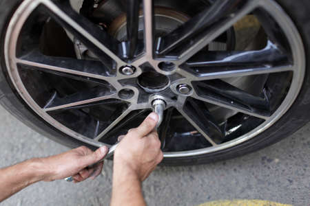 It is car wheel installation on the road photo
