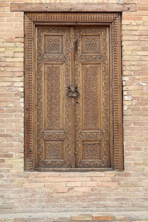 registan: Wooden door in Guri Amir mausoleum in Samarkand, Uzbekistan Editorial