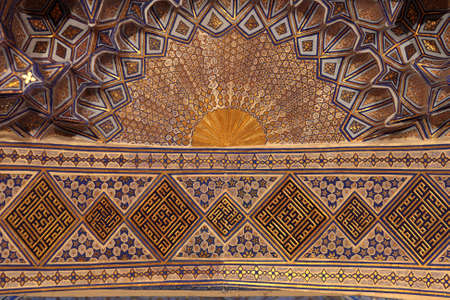 Golden ceiling of Guri Amir. It is a mausoleum of the Asian conqueror Tamerlane in Samarkand, Uzbekistan Editorial
