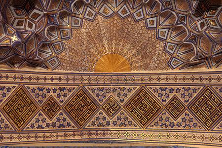 Golden ceiling of Guri Amir. It is a mausoleum of the Asian conqueror Tamerlane in Samarkand, Uzbekistan Redactioneel