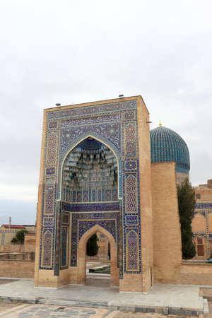 registan: Gate of Guri Amir. It is a mausoleum of the Asian conqueror Tamerlane in Samarkand, Uzbekistan Stock Photo