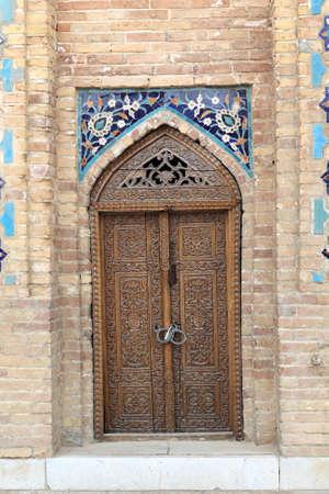 registan: Wooden door of Guri Amir. It is a mausoleum of the Asian conqueror Tamerlane in Samarkand, Uzbekistan