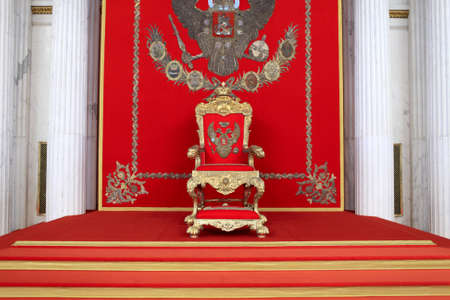 The great imperial throne in the St George Hall in the Winter Palace, Saint Petersburg, Russia