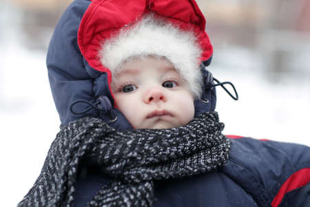 Portrait of serious baby in winter, Russia photo