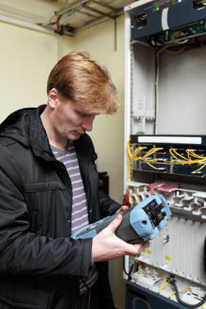 Telecom engineer learning reflectometer on the site Stock Photo - 11867119