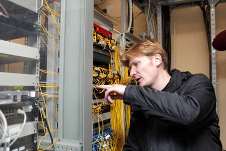 The network technician is working on the telecom site photo