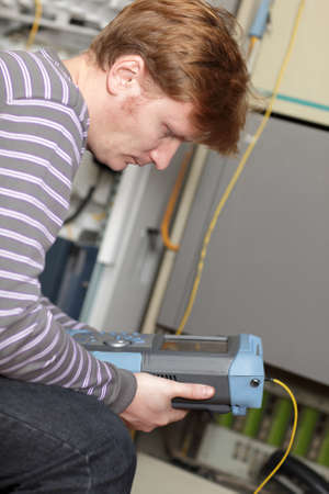 The technician analysis measuring results at the server room Stock Photo - 12062634