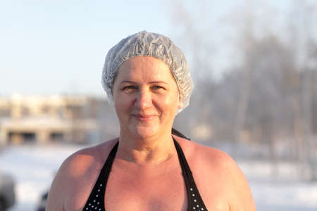 The woman posing after winter swimming, Siberian photo