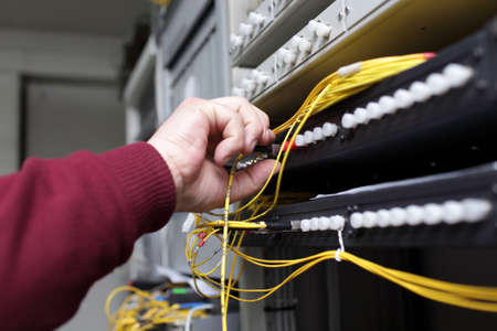 IT technician connecting ODF with telecom equipment