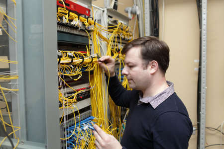The network engineer jumpering fibre optic on optical distribution frame photo