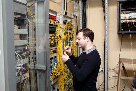The technician makes cross connections on a optical distribution frame