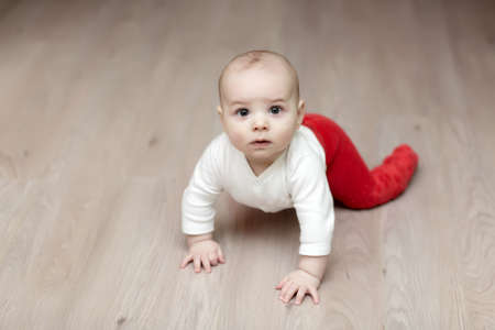 Portrait of baby on parquet at home Stock Photo - 12208390