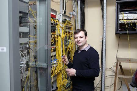 Portrait of IT technician at a server room