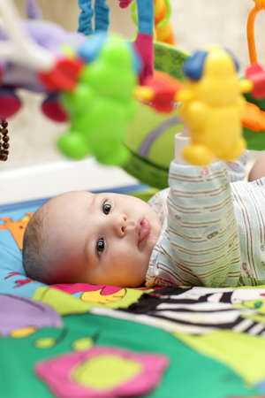 The serious baby boy playing at home Stock Photo - 12580711