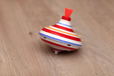 whirligig: The striped whirligig is lying on a parquet Stock Photo