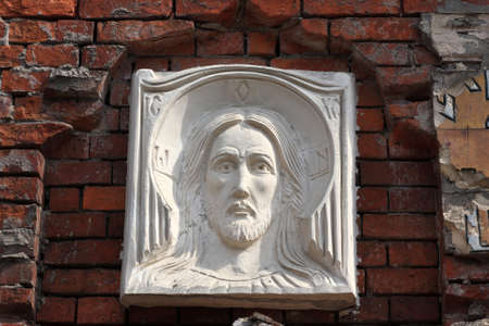 Icon of Jesus on wall of brick chapel, Krasnogorsk, Russia Stock Photo - 13516863