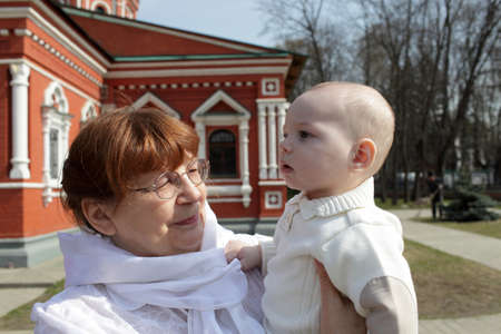 Portrait of grandmother and child by russian orthodox church Stock Photo - 13525527