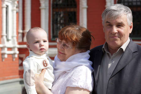 Grandparents and child posing by russian orthodox church Stock Photo - 13525569