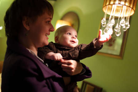 The child playing with a chandelier at cafe Stock Photo - 13572299