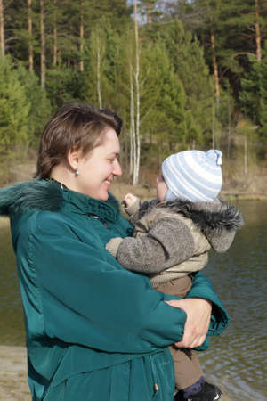 Mother and child on a lakeside in summer Stock Photo - 14009370
