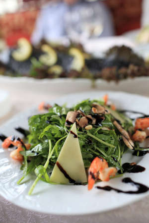 Arugula salad with cheese, mushrooms and seafood Stock Photo - 14052835