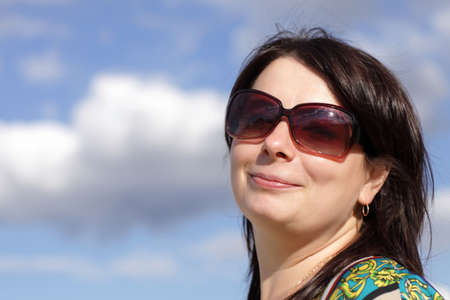 Portrait of happy brunette on the sky background Stock Photo - 14351461