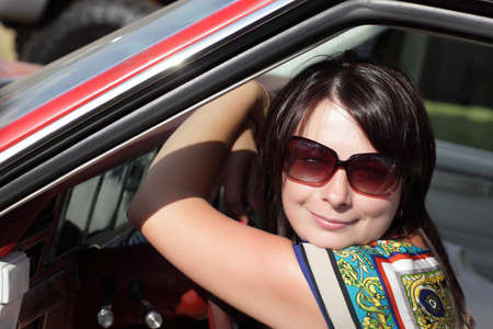 Portrait of happy woman in a car Stock Photo - 14351498