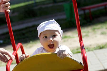 Happy child is having fun on a swing Stock Photo - 14469701