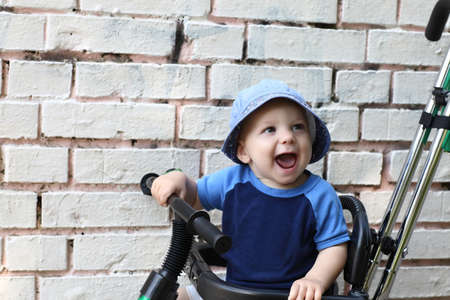 Portrait of excited child on a brick wall background photo