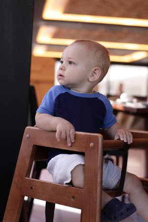 highchair: Portrait of baby baby in a restaurant