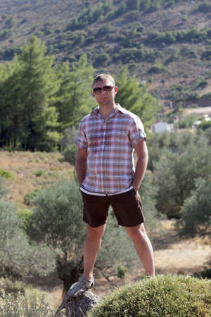 Man is posing on valley background in Rhodes, Greece photo