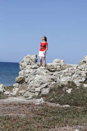 Portrait of a girl on a cliff, Rhodes, Greece Stock Photo - 15847772