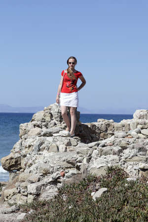 Teen is posing on a cliff, Rhodes, Greece Stock Photo - 15971858