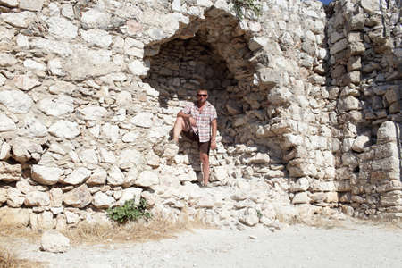 Tourist on the wall castle of Monolithos background, Rhodes, Greece Stock Photo - 15971856
