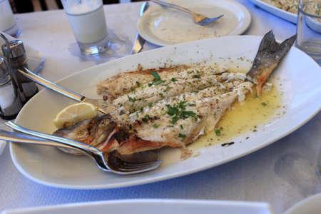 Prepared Dorado fish on a white plate Stock Photo - 16217928