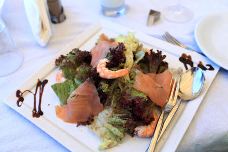 Seafood salad on a white plate in a restaurant Stock Photo - 16217915