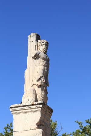 Triton on the sky background, Odeion of Agrippa, Athens, Greece photo
