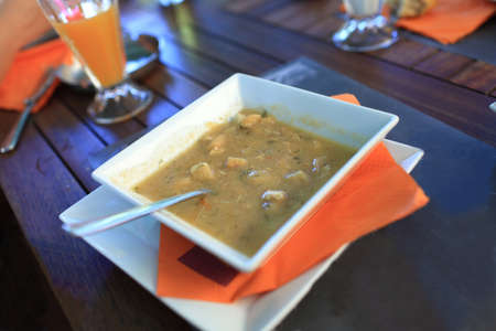 Fish soup on a white plate in a greek taverna Stock Photo - 16451243