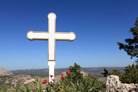 Cross on sky background in Tsambika monastery, Rhodes island, Greece photo