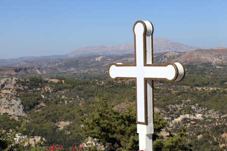 tsampika: Cross on valley background in Tsambika monastery, Rhodes island, Greece Stock Photo
