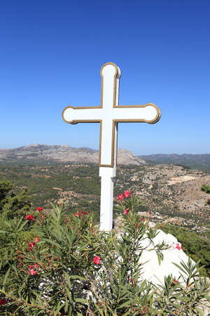 White cross in Tsambika monastery, Rhodes island, Greece photo