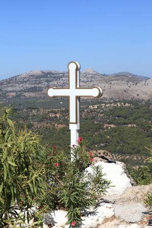 tsampika: White cross of Tsambika monastery on Rhodes island, Greece