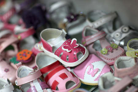 The children footwear are in a store photo