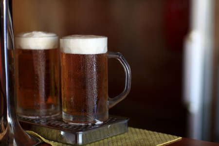 Two glass of cold beer in a restaurant Stock Photo - 16683898