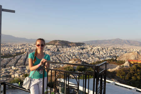 The girl is posing on Athens background, Greece Stock Photo - 16683996